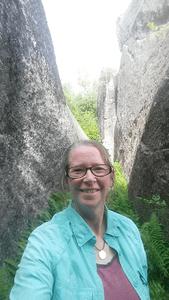Me, standing between two fragments of Daggett Rock, Phillips, ME