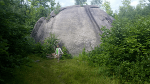 """Earl is 6' 3"""". Daggett Rock is approximately 25-feet high."""