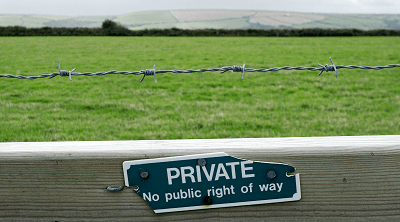 Boundary sign on fence
